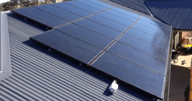 solar panels installed on tin roof