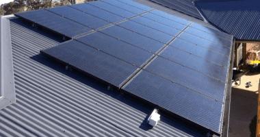 solar panels installed on tin roof